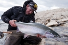 Nick Reygaert takes a break from filming to catch a giant rainbow trout in Patagonia. Picture / Geoff Thomas
