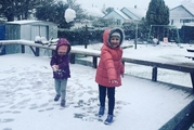 When you've got the right attire, snowballs are heaps of fun - rugged up in the hills of Dunedin yesterday. Photo / Supplied