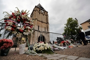 Flower tributes have been left outside the church where 86-year-old priest Father Jacques Hamel died. Picture / AP