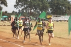 Zane Robertson leads out a 1500m race in Kenya.