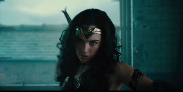 Loading The teaser moves on to Wonder Woman moving away from the lush island of Themyscira into modern civilization.
