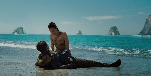 The preview opens with Wonder Woman, played by Gal Gadot, leaning over Steve Trevor (Chris Pine) after he has washed up on a beach.