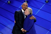 While Barack Obama and Hillary Clinton shared the love in Philadelphia, Donald Trump urged Russia to hack and share Clinton's emails. Pictures / AP