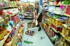 Paparoa Store owner Robert Hinsch clears up the damage caused by an earthquake on December 18, 2003, the most recent earthquake that caused any significant damage in Northland.
