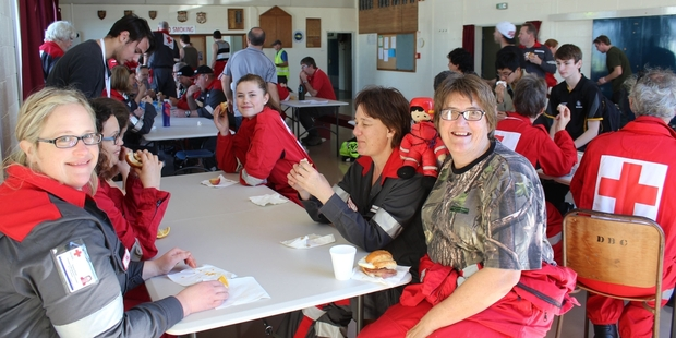 The Red Cross crews taking part in Exercise Viking Thunder in Dannevirke last weekend were kept fed by the Salvation Army. Emma Kidd, of the Whanganui Red Cross team (left) with Fiona Fliss of Wairarapa (right) and Charlie the mascot. Photo / Christine McKay