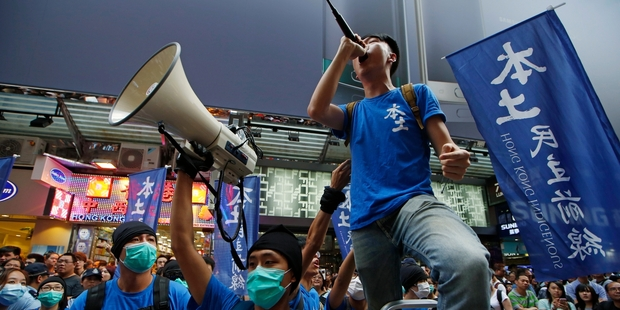 Edward Leung of Hong Kong Indigenous shouts slogans with his supporters during a demonstration in Hong Kong. Picture / AP