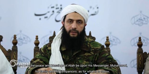 An image grab taken from a video broadcast on by Dubai-based Orient News satellite television shows the head of Al-Nusra Front in Syria, Abu Mohamad al-Jolani.