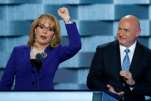 Former Congresswoman Gabby Giffords and her husband retired astronaut Mark Kelly. Photo / AP