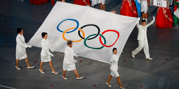 The Olympic flag is carried into The National Stadium during the Parade of Nations at the 2008 Beijing Olympics. Photo / Kenny Rodger