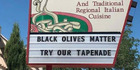 Restaurant slammed for 'black olives matter' sign