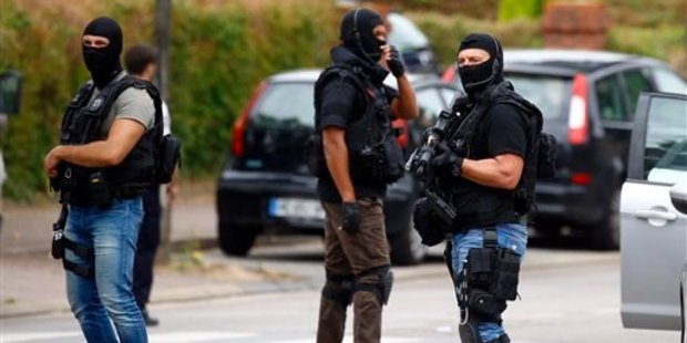 Police conduct a search in Saint-Etienne-du-Rouvray following an attack on a church that left a priest dead. Photo / AP