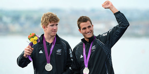Peter Burling and Blair Tuke celebrate on the podium after winning silver in the 49er sailing class at the London 2012 Olympic Games. Photo / Getty Images