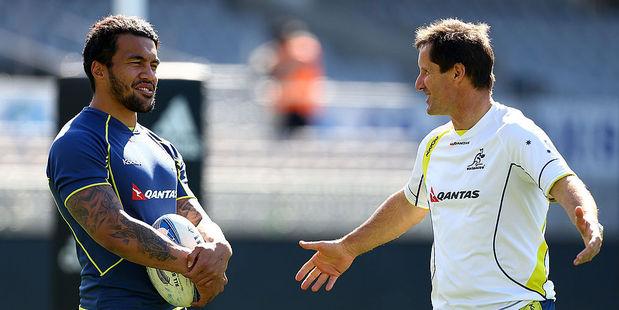 Digby Ioane and coach Robbie Deans talk during an Australian Wallabies captain's run. Photo / Getty Images