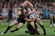Ryan Hoffman of the Warriors is tackled during the round 10 NRL match between the Penrith Panthers and the New Zealand Warriors at AMI Stadium. Photo / Getty Images