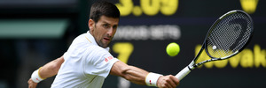 Novak Djokovic plays a backhand during Wimbledon. Photo / Getty Images