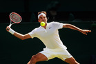 Roger Federer plays a forehand during Wimbledon. Photo / Getty Images