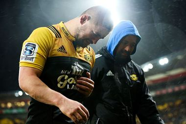Captain Dane Coles of the Hurricanes leaves the field with an injury. Photo / Getty