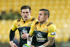 TJ Perenara (right) makes a break with Hurricanes teammate Jason Woodward in support. Photo / Getty Images