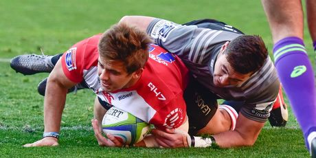The Lions' Rohan Janse van Rensburg scores a try during their quarter-final against the Crusaders. Photo / Getty