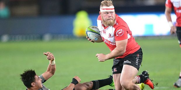 Armand van der Merwe of the Lions bumps off Richie Mo'unga of the Crusaders. Photo / Getty