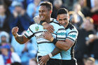 Ben Barba of the Sharks celebrates with teammate Valentine Holmes. Photo / Getty