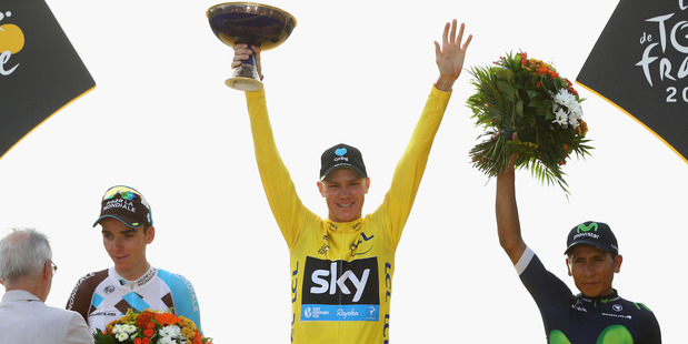Chris Froome (centre) celebrates winning the 2016 Tour de France. Photo / Getty Images