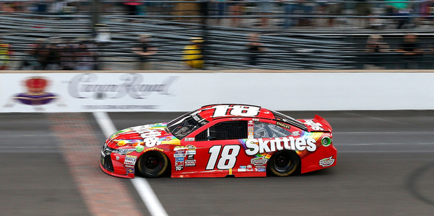 Kyle Busch takes the checkered flag at the Combat Wounded Coalition 400. Photo / Getty Images