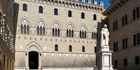 View of the main facade of Monte dei Paschi di Siena, the oldest bank in the world, founded in 1472 as a mount of piety (ancient pawnshop).