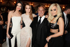 From Left: Kendall Jenner, Cara Delevingne, Sir Philip Green and Rita Ora at a drinks reception at the British Fashion Awards. Photo / Getty