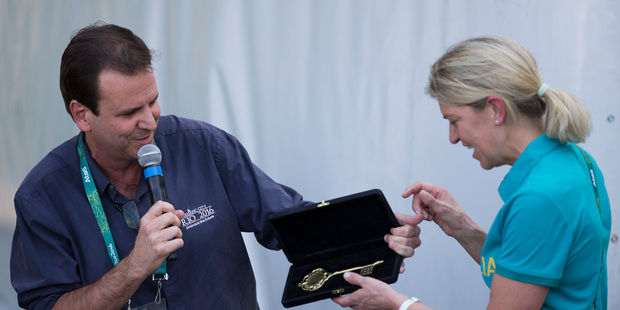 Rio de Janeiro's mayor Eduardo Paes, left, hands the City's Key to Australia's delegation head Kitty Chiller during a ceremony at the Olympic Village in Rio de Janeiro. Photo / AP