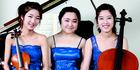 Stella Kim (violin), Inah Kim (piano) and Sally Kim (cello) are The Trinity Trio. Photo/supplied