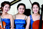 Stella Kim (violin), Inah Kim (piano) and Sally Kim (cello) are The Trinity Trio. Photo/supplied