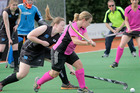 Whanganui's Lisa Grant looks to get her shot on goal through the College Development defence at Gonville on Saturday.