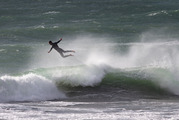 A surfer gets some air at Tay St Beach, Mt Maunganui, this morning, no doubt helped by the powerful offshore winds that buffeted the North Island. Photo / Alan Gibson