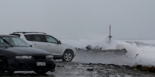 Despite warnings to keep away  onlookers flocked to Morgan St to watch big seas pounding the North Mole. PHOTO/BEVAN CONLEY