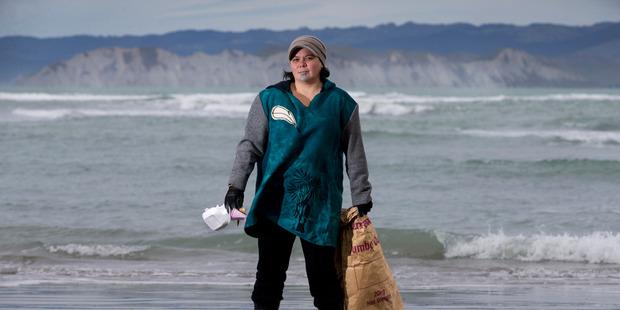 Loading Tina Ngata on Kaiti Beach, Gisborne, with the rubbish she has picked up on the sand. Photo / Alan Gibson