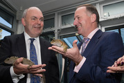 Science and Innovation Minister Steven Joyce, and Prime Minister John Key are introduced to two tuatara after announcing the Government's new predator-free by 2050 policy. Photo / Mark Mitchell