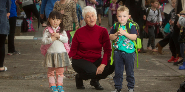 Loading Otonga Road Primary School principal Linda Woon with Gege Zhou, 5, left, and Royce Sanford, 5, on their first day of school.  Photo/Ben Fraser