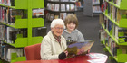Phyllis Sturmfels (left) read a book to Leon Barnett, 7, at the new library location yesterday morning. PHOTO/BEN FRASER