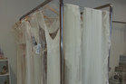 Wedding dresses hang on a rack in the display room of Primrose and Finch wedding dress shop on Khyber Pass Road in Auckland. Photo / Supplied