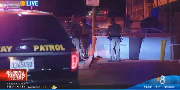 Police in attendance at an address in San Diego after two officers were shot. Photo / CBS