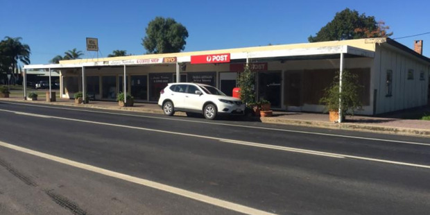 A large chunk of the town's commercial precinct - seven shops - along with a three bedroom home, will all be offered at auction this Saturday with no reserve price. Photo / Supplied