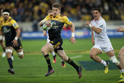 Hurricanes first five-eighths Beauden Barrett breaking the Chiefs defence to set-up his team's first try in their 2016 Invested Super Rugby semi-final. Photo / Mark Mitchell