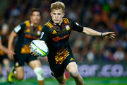 Damian McKenzie of the Chiefs runs the ball during the round 11 Super Rugby match between the Chiefs and the Highlanders on May 7, 2016 in Hamilton. Photo / Getty Images.