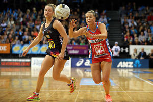 Swifts' Kimberlee Green passes with Magic's Jamie-Lee Price chasing during the ANZ Championship semi-final. Photo / Getty Images