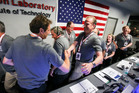 Scott Bolton, left, celebrates in Mission Control at NASA's Jet Propulsion Laboratory as the solar-powered Juno spacecraft goes into orbit around Jupiter. Photo / AP