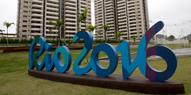 The Rio 2016 sign stands in front of the Olympic Village during a media tour in Rio de Janeiro, Brazil, Thursday, June 23, 2016. The organizers of the Rio de Janeiro Olympics have unveiled the athlete