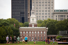 Visitors walk in view of Independence Hall in Philadelphia. Photo / AP