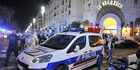 A Police car is parked near the scene of an attack in Nice. Photo / AP