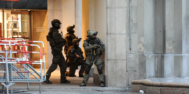 Heavily armed police forces operate at Karlsplatz (Stachus) square after a shooting in the Olympia shopping centre. Photo / AP